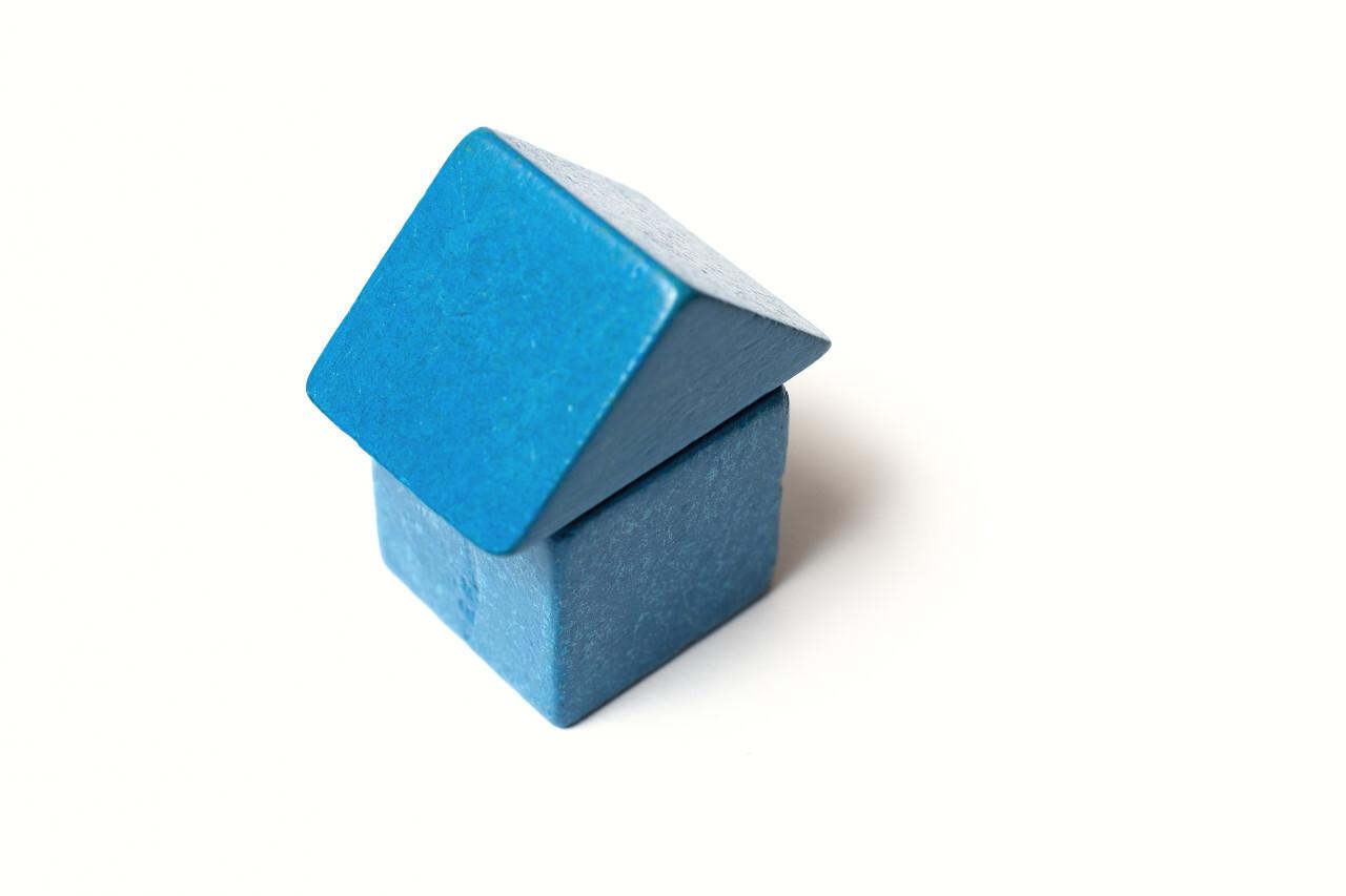 blue toy block house white background