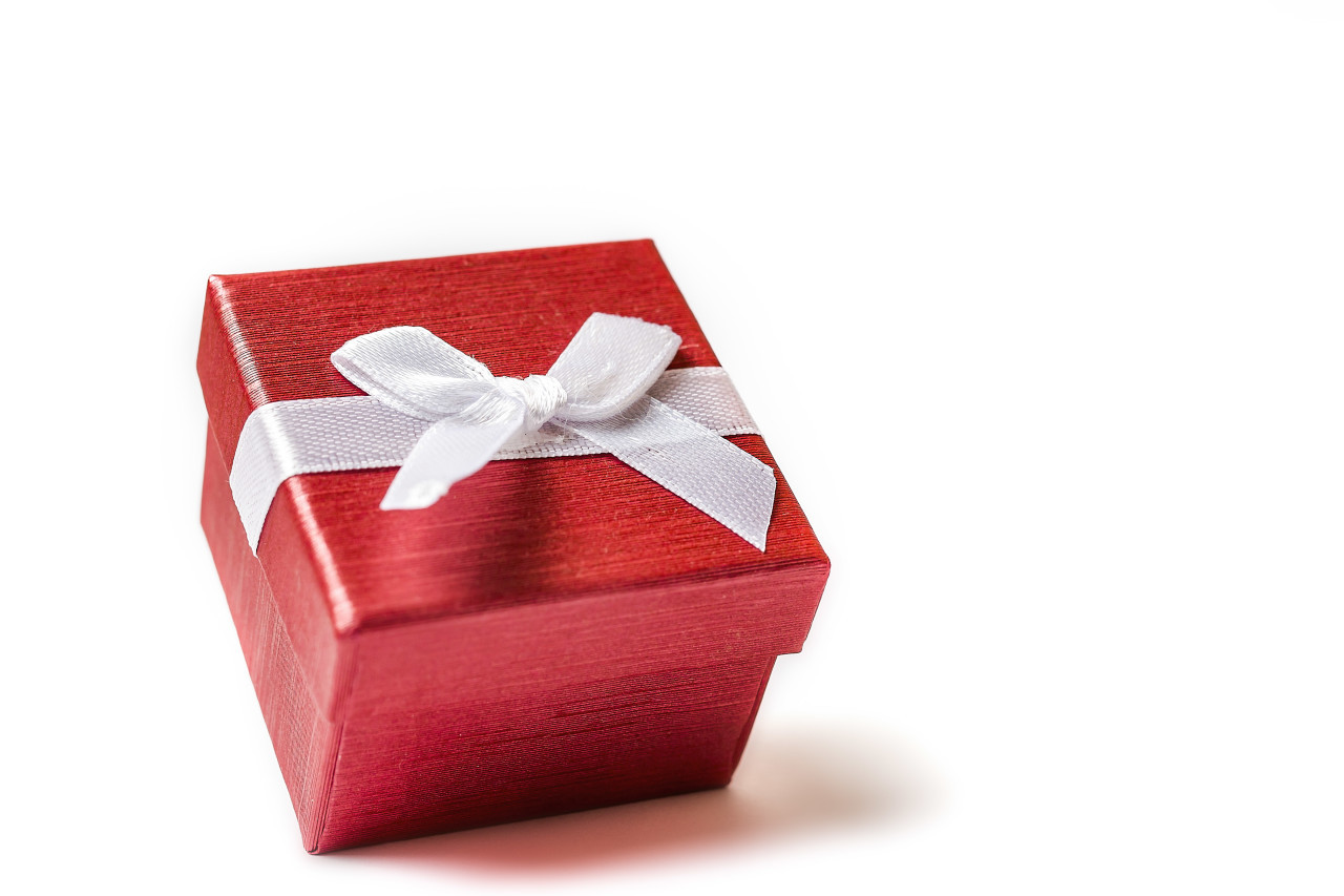red wrapped gift box isolated on white background