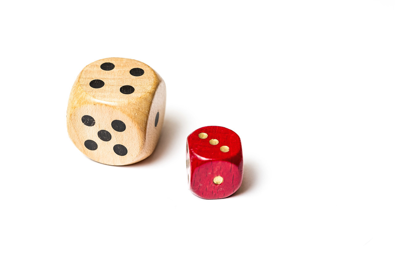 small red and big white dice isolated on white background