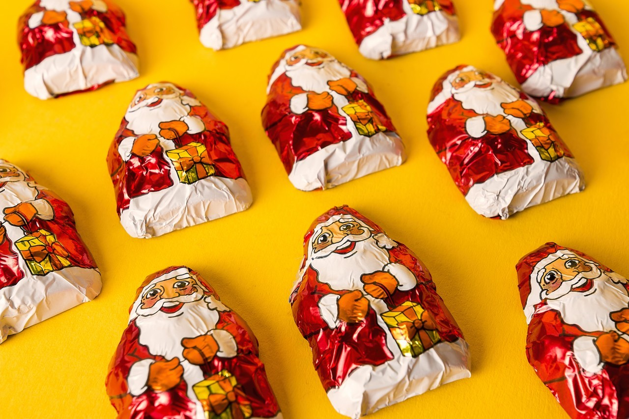 chocolate santas on a yellow background