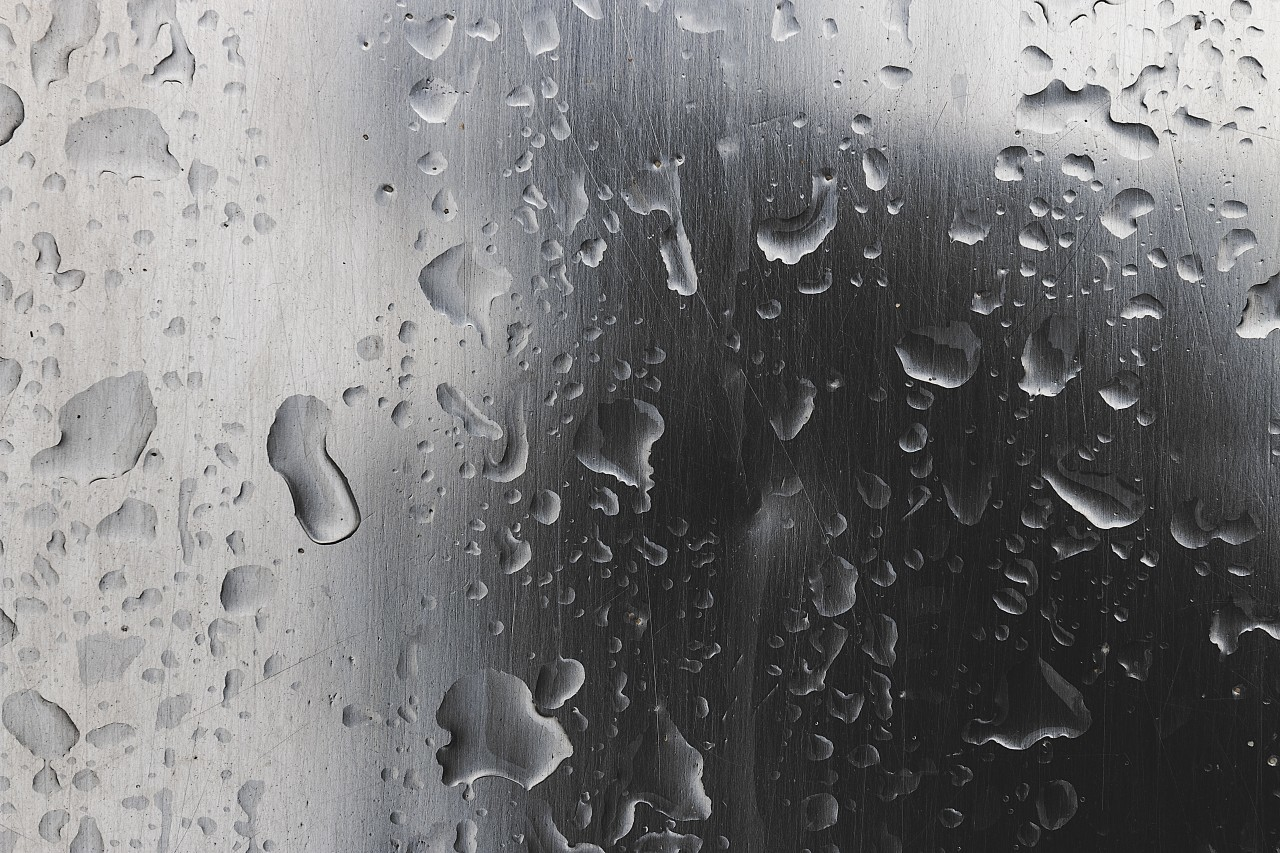 polished wet steel raindrops background texture