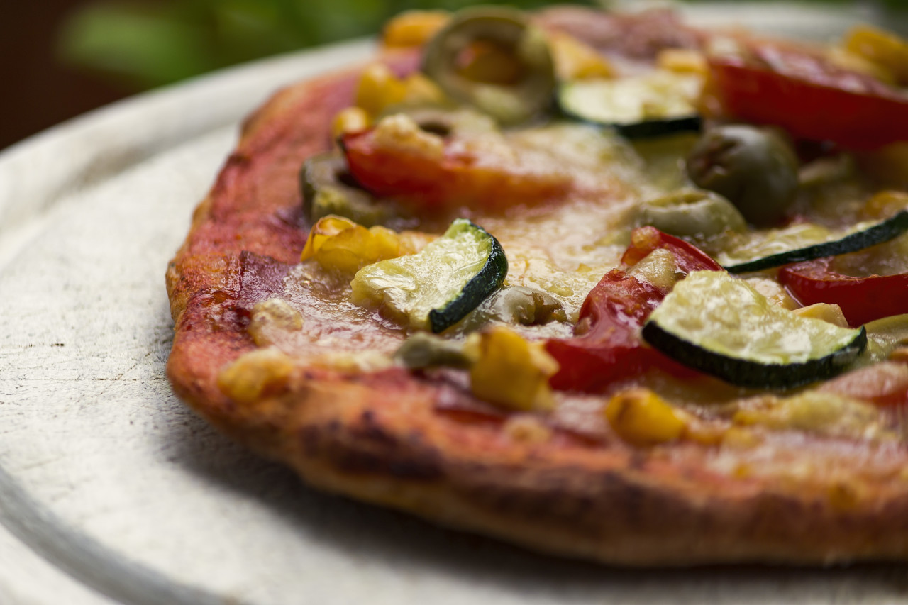 pizza with zucchini spinach olives corn tomatoes