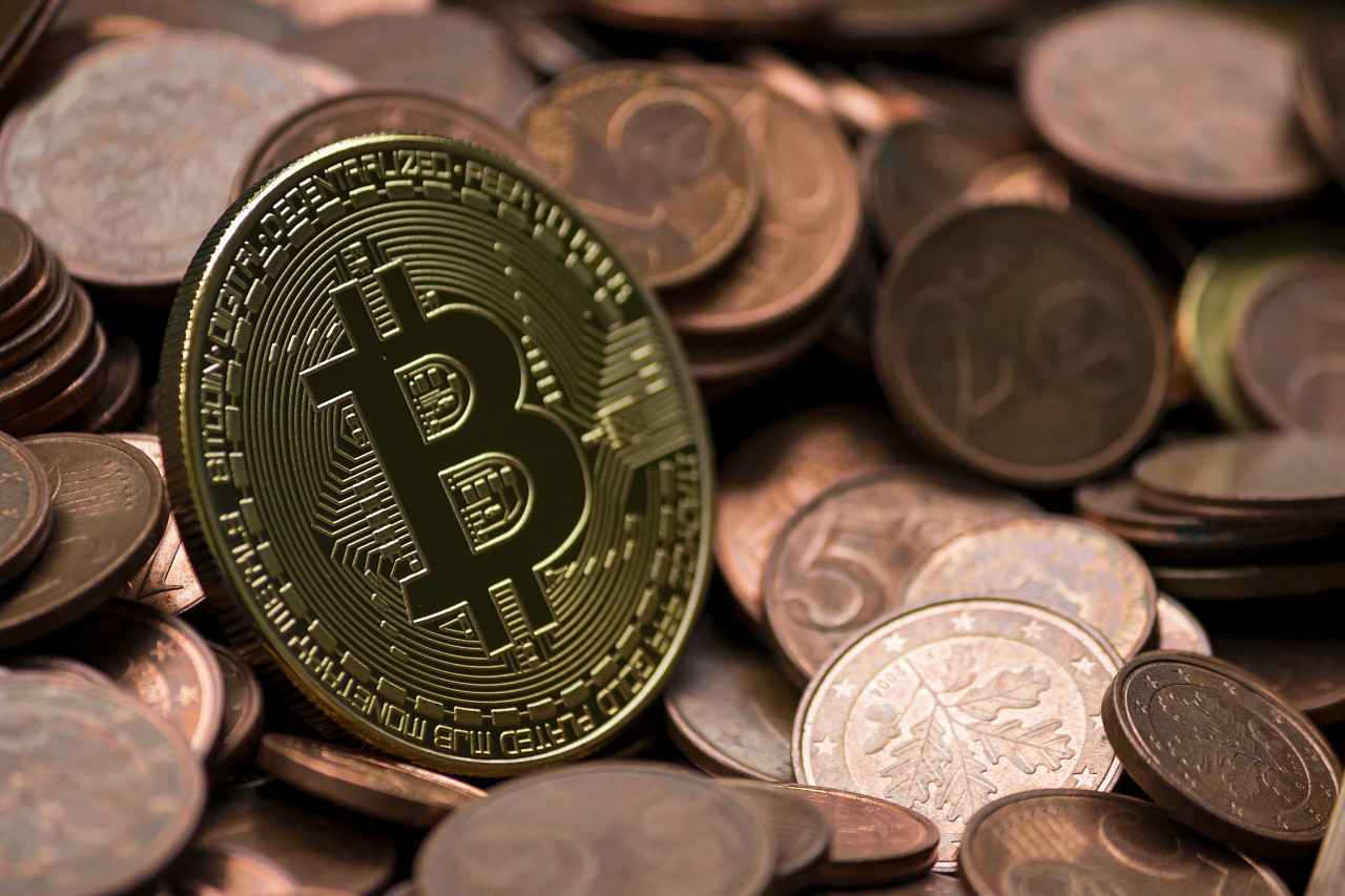 Bitcoin between euro coins