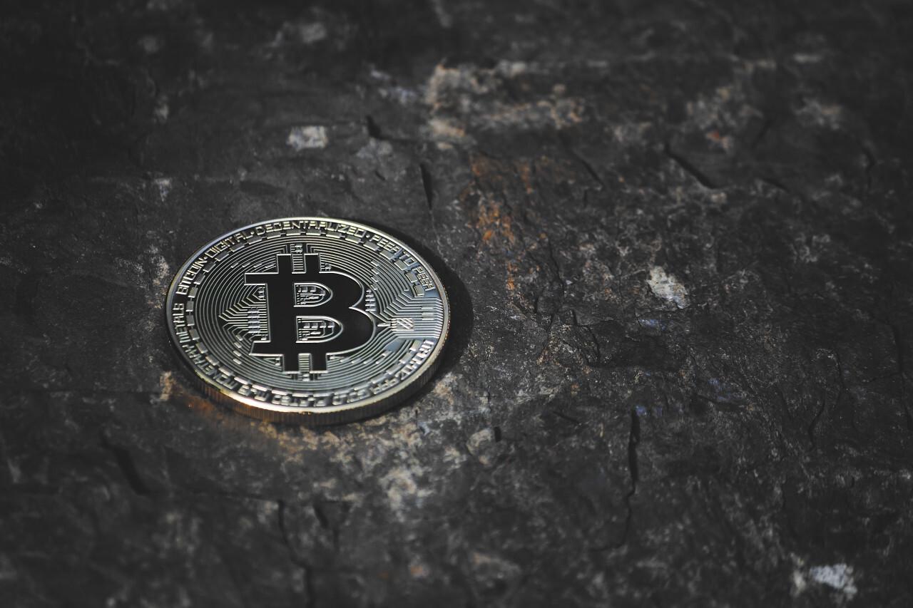 bitcoin on dark stone background