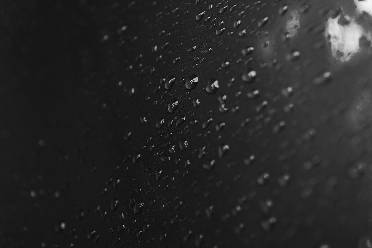 raindrops on a black surface background