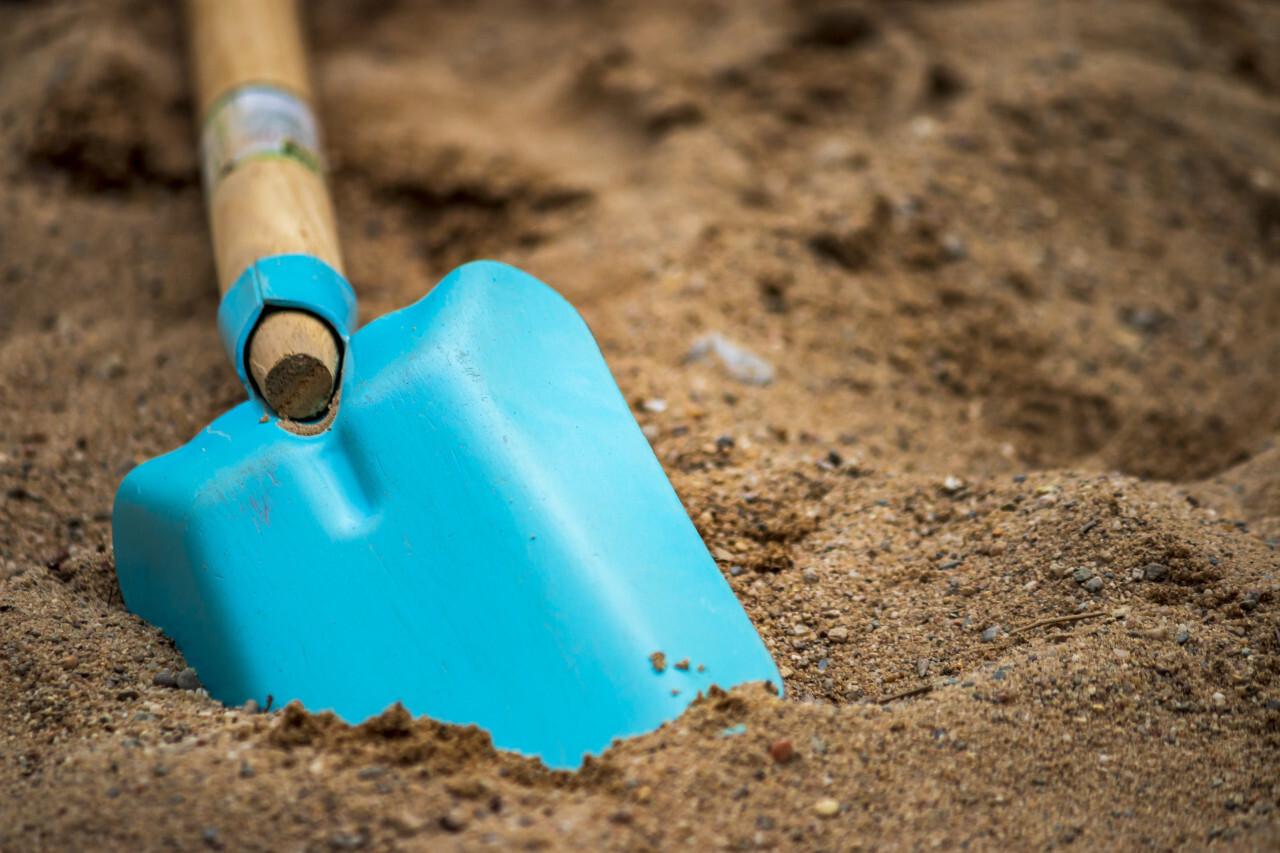 Blue Shovel in Sand