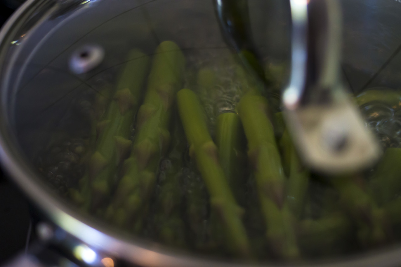 green asparagus cooks in the pot
