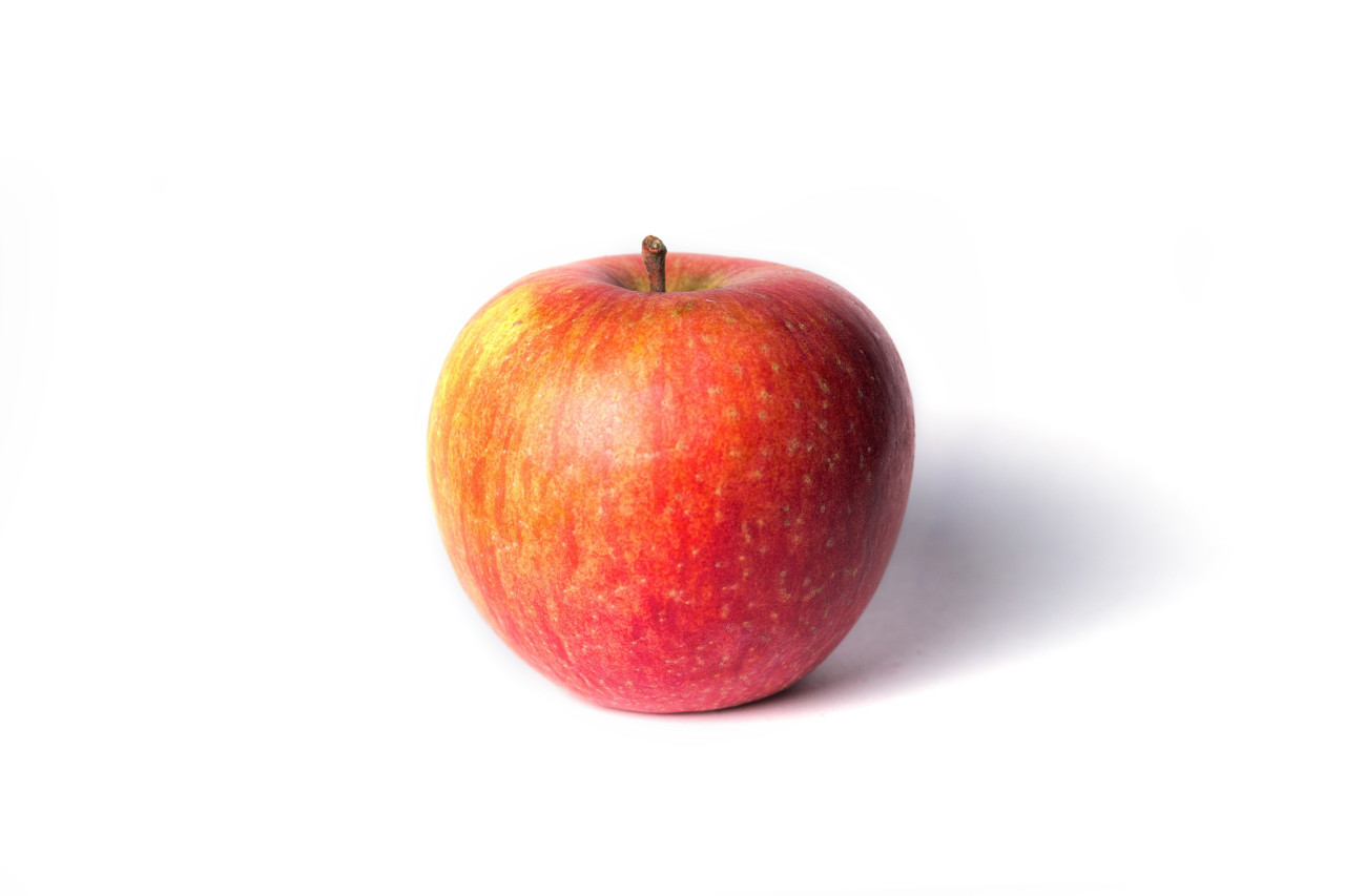 Fresh red apple isolated on white background