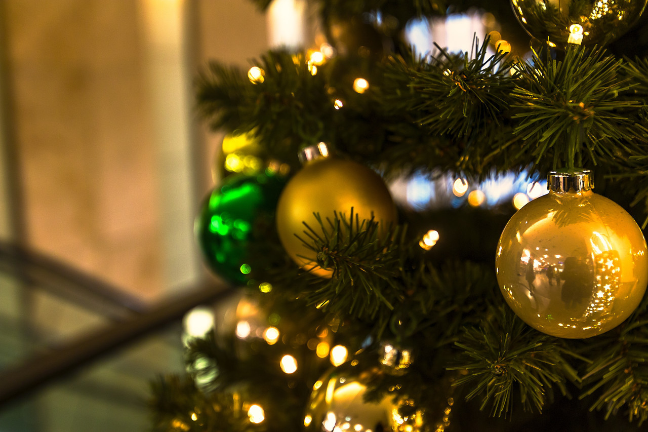 christmas tree with golden balls in a shopping mall