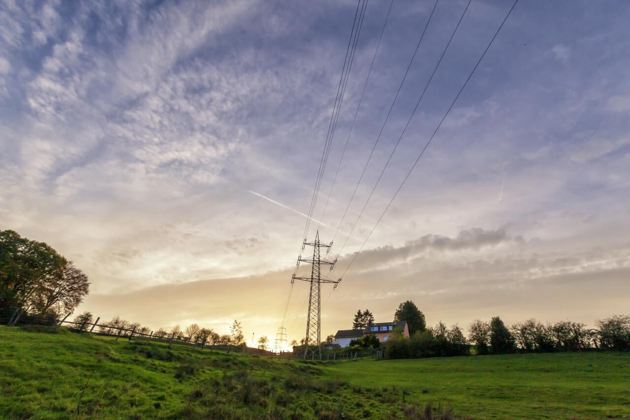german rural autumn landscape marscheider bachtal in nrw power poles by sunset