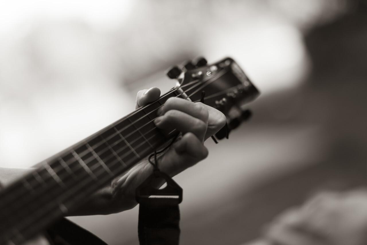 hand on guitar