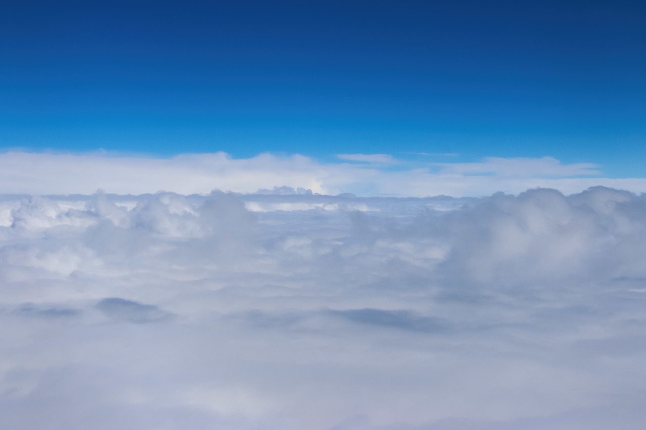 Clouds and sky from airplane window view
