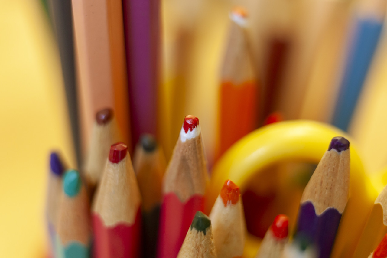 Colored pencils closeup as background