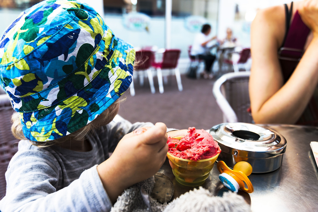 child with strawberry ice cream cup