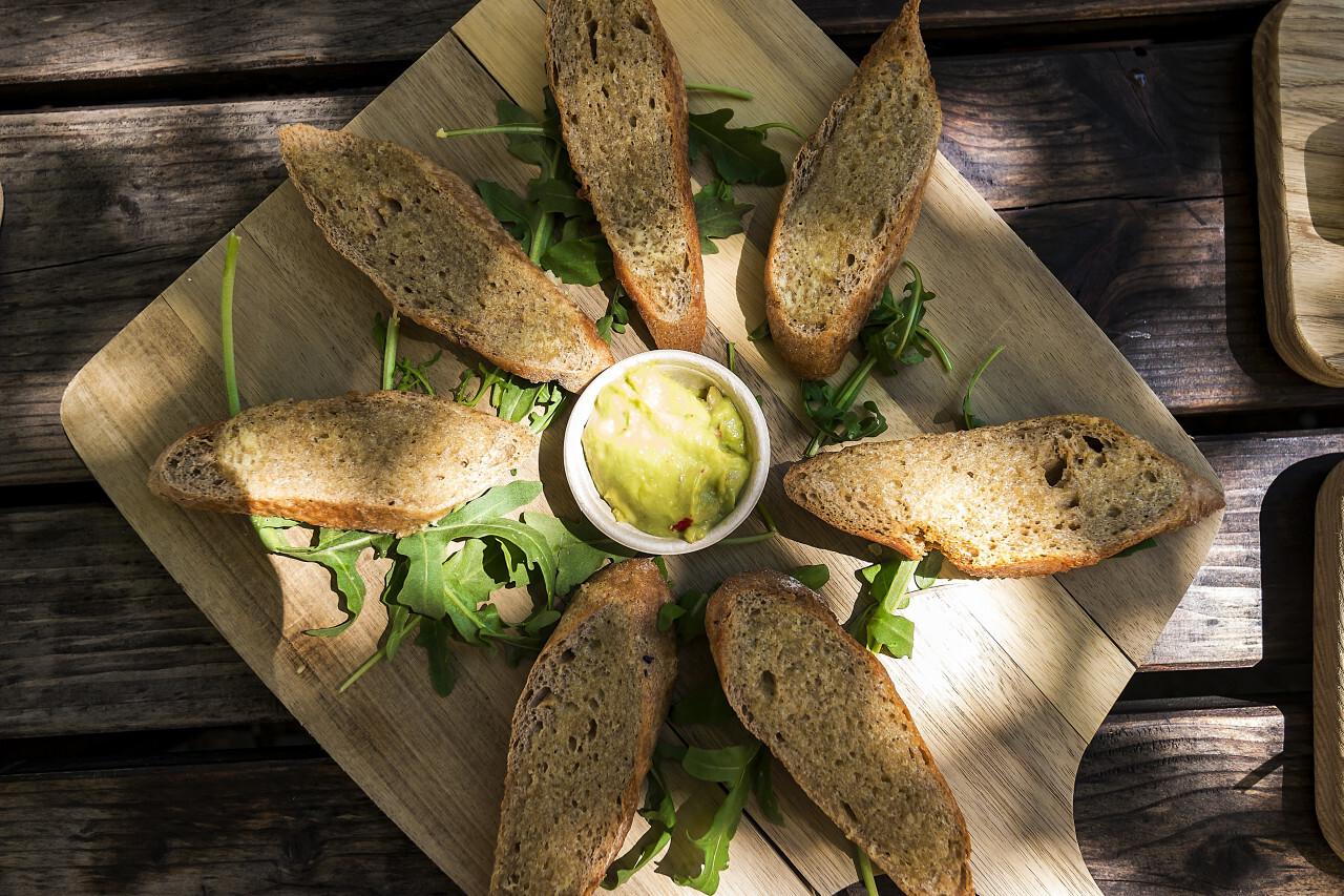 garlic baguette slices with guacamole dip