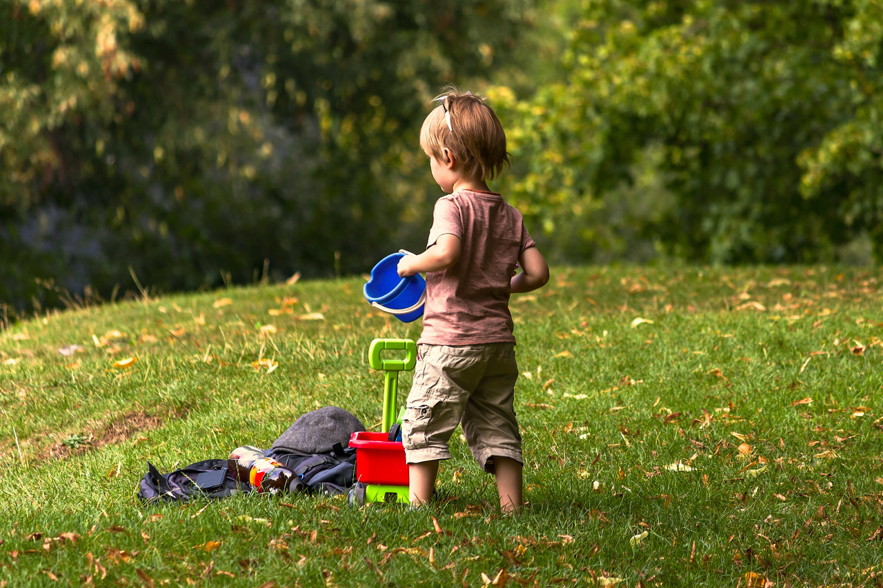 little child with bucket