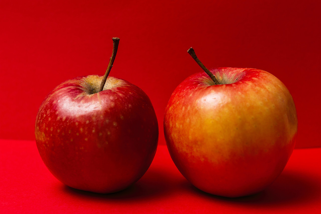 red apples red background