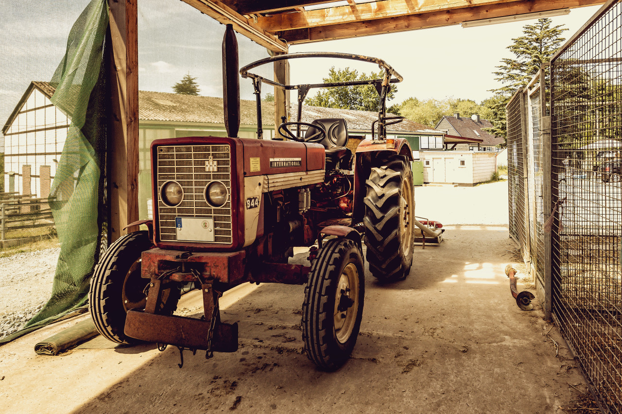 old vintage tractor on a farm