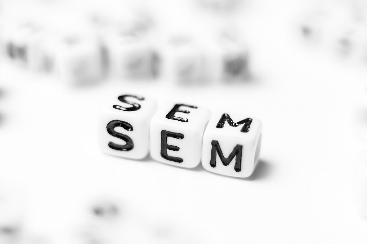 SEM as a word - bright dice font concept