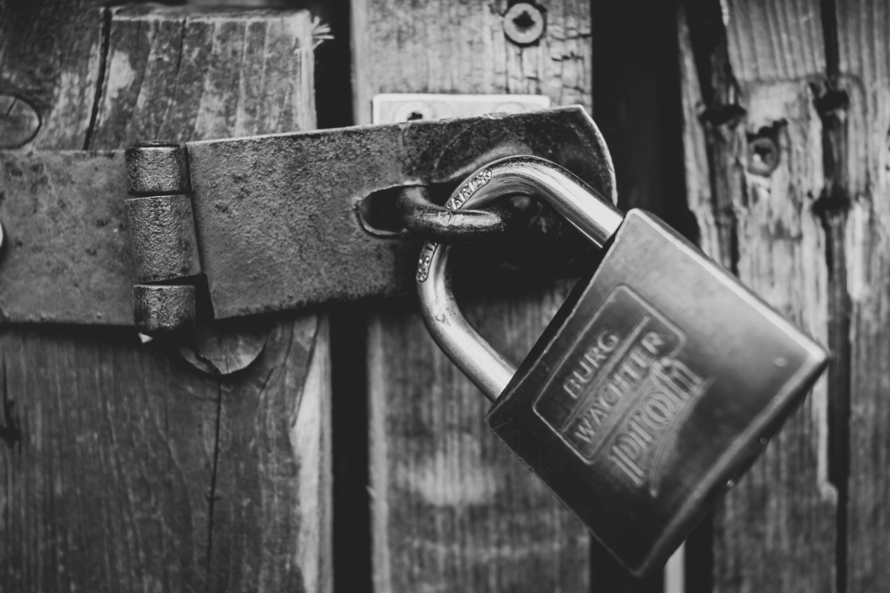gate with padlock black and white