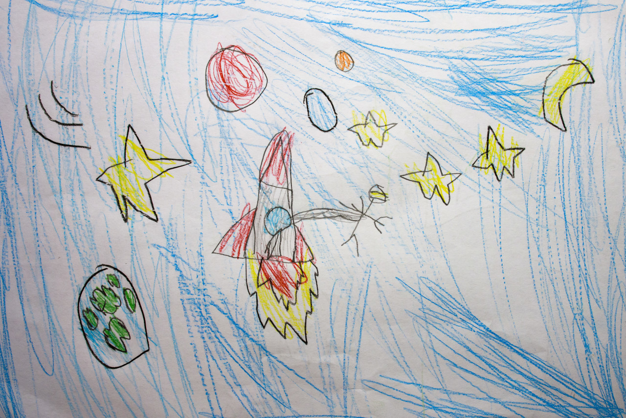 Rocket in space with an astronaut and some planets. Painted by a 6 year old child.
