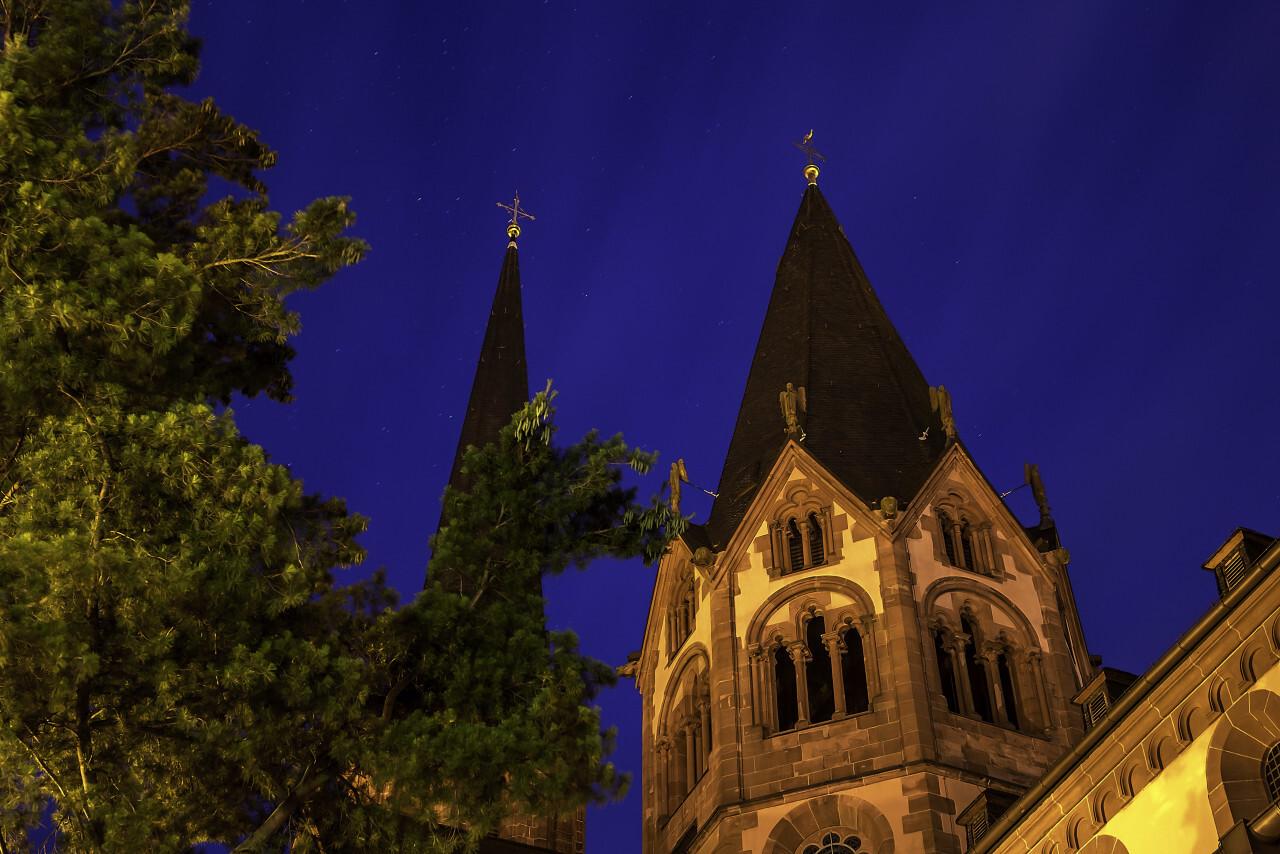 Church at night under stars - Marienkirche by Gelnhausen, Frankfurt am Main in Germany