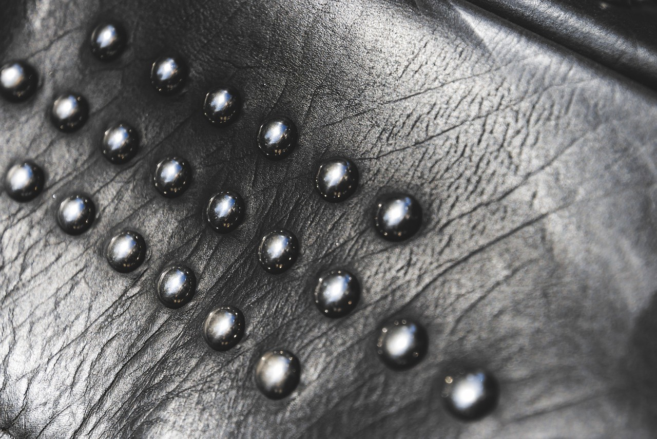 black leather with rivets