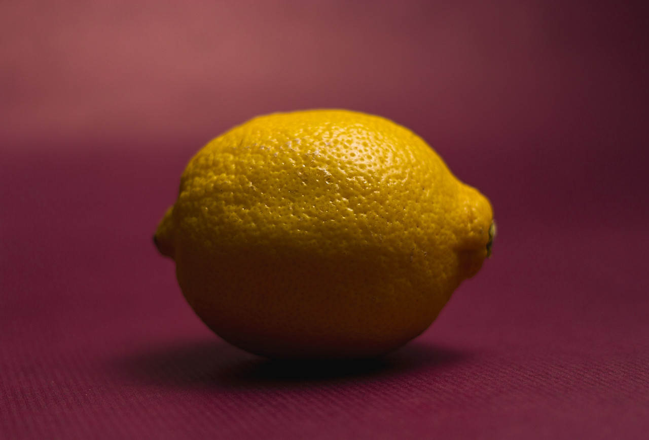 yellow lemon lime on a pink background
