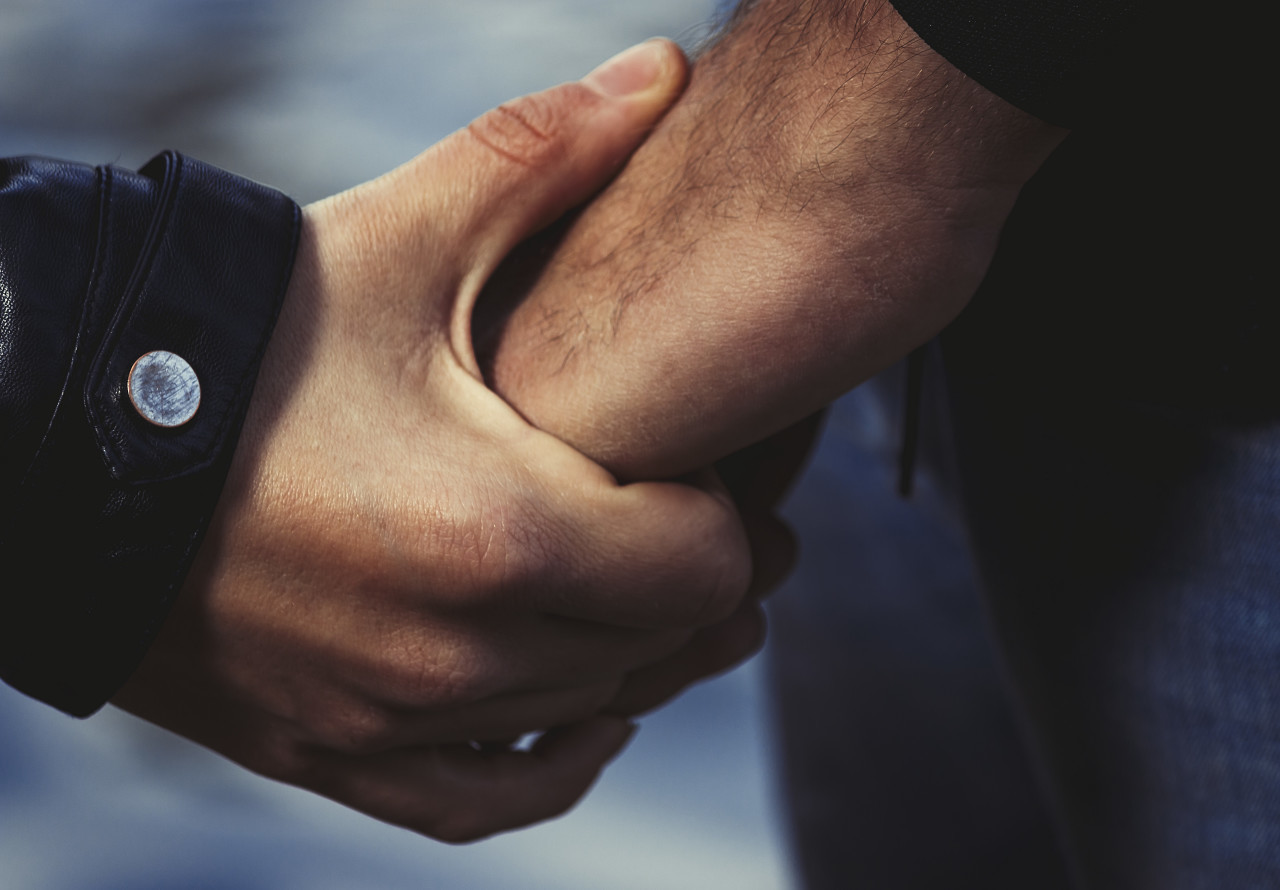 couple is holding hands