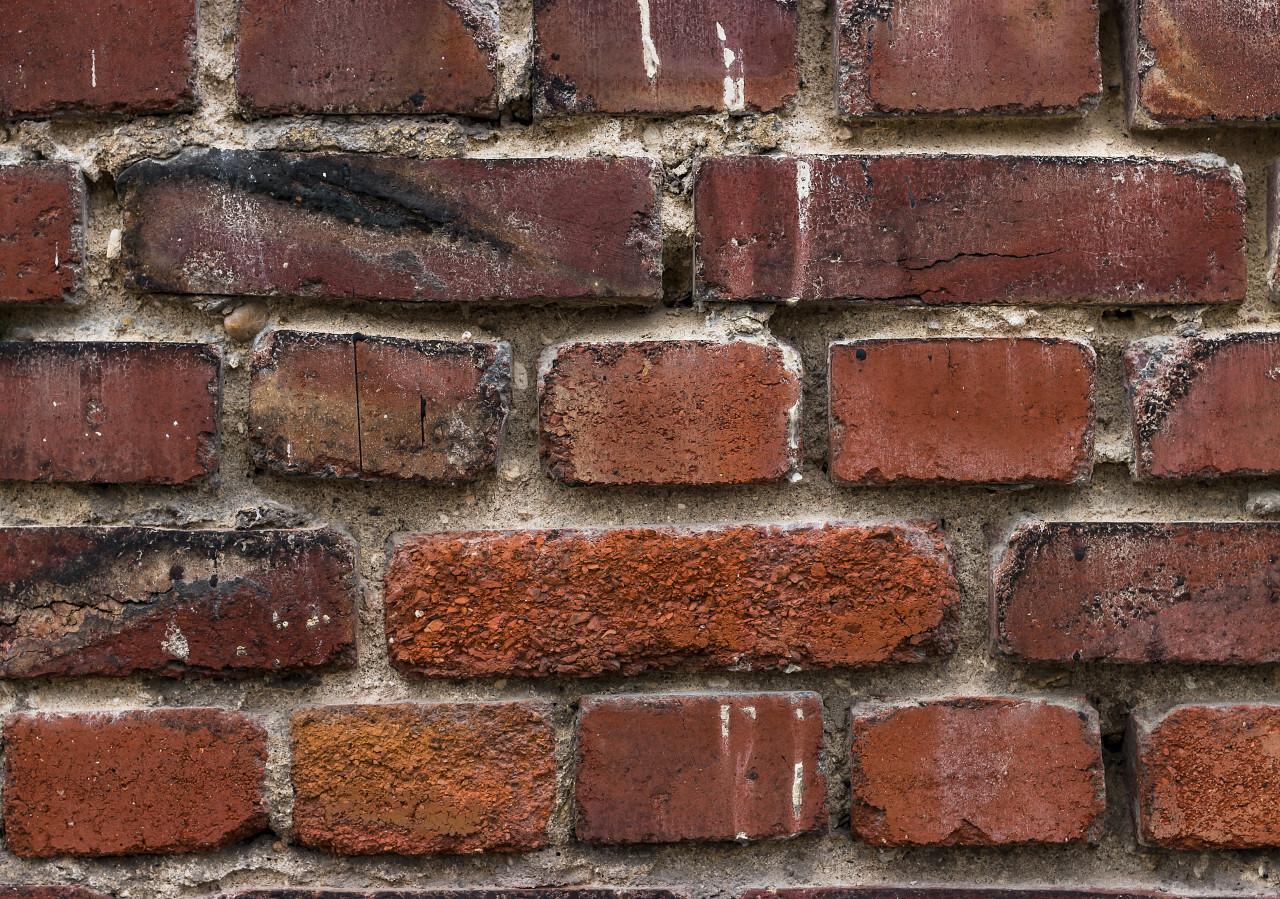 worn old red brick texture background