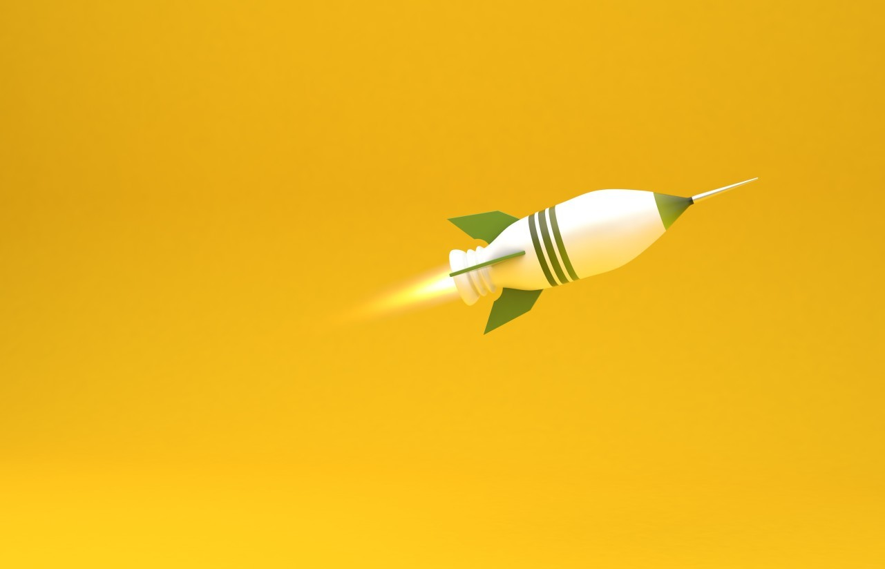 green and white rocket on yellow background
