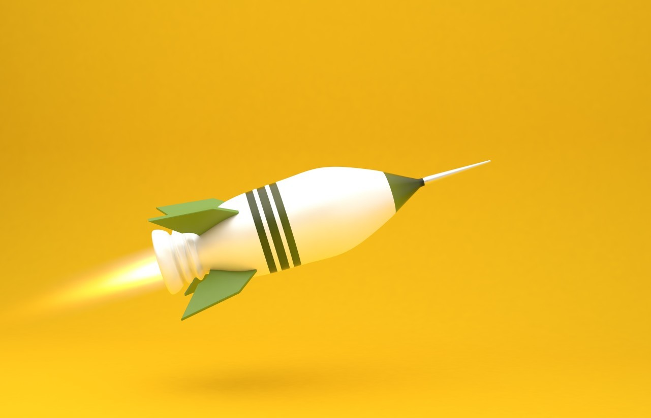 big green rocket on yellow background