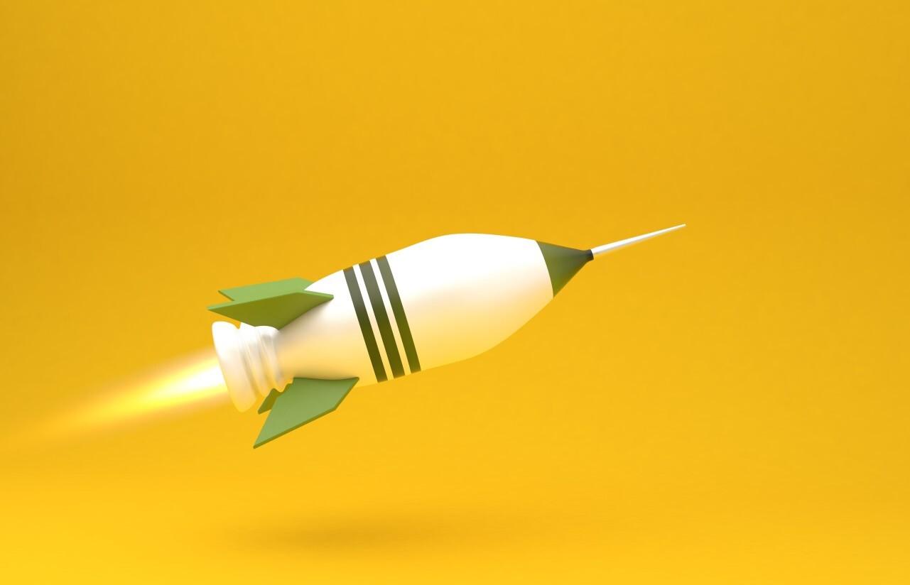 big green rocket on yellow background
