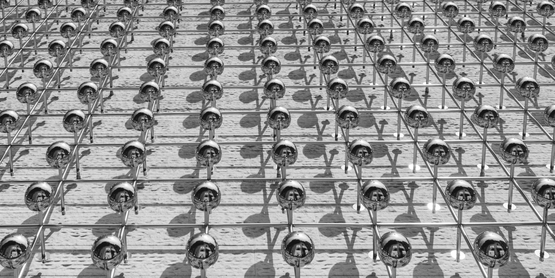 Modern architecture chrome-plated spheres on building facades