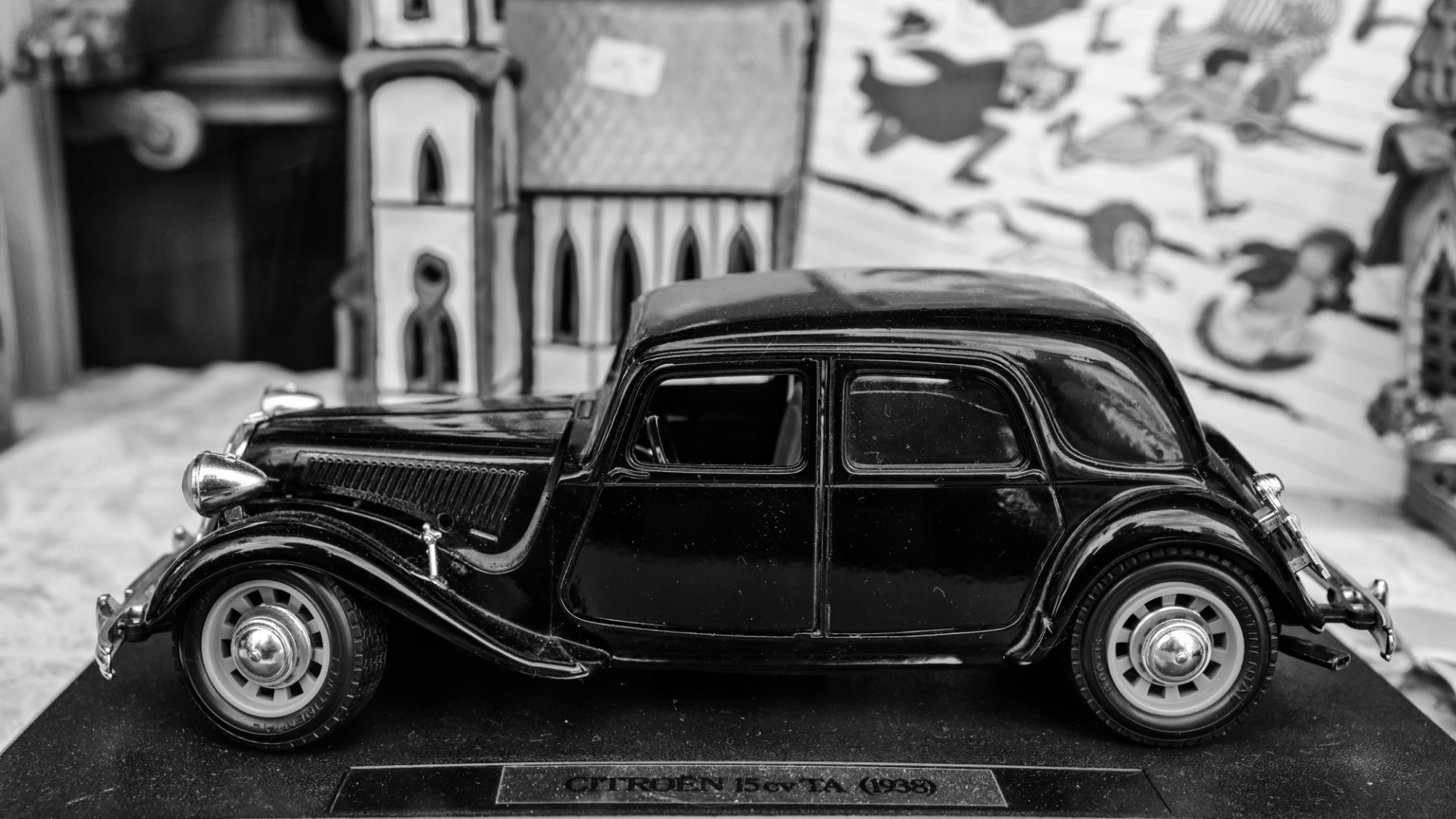 Model car in a window of an antiques shop