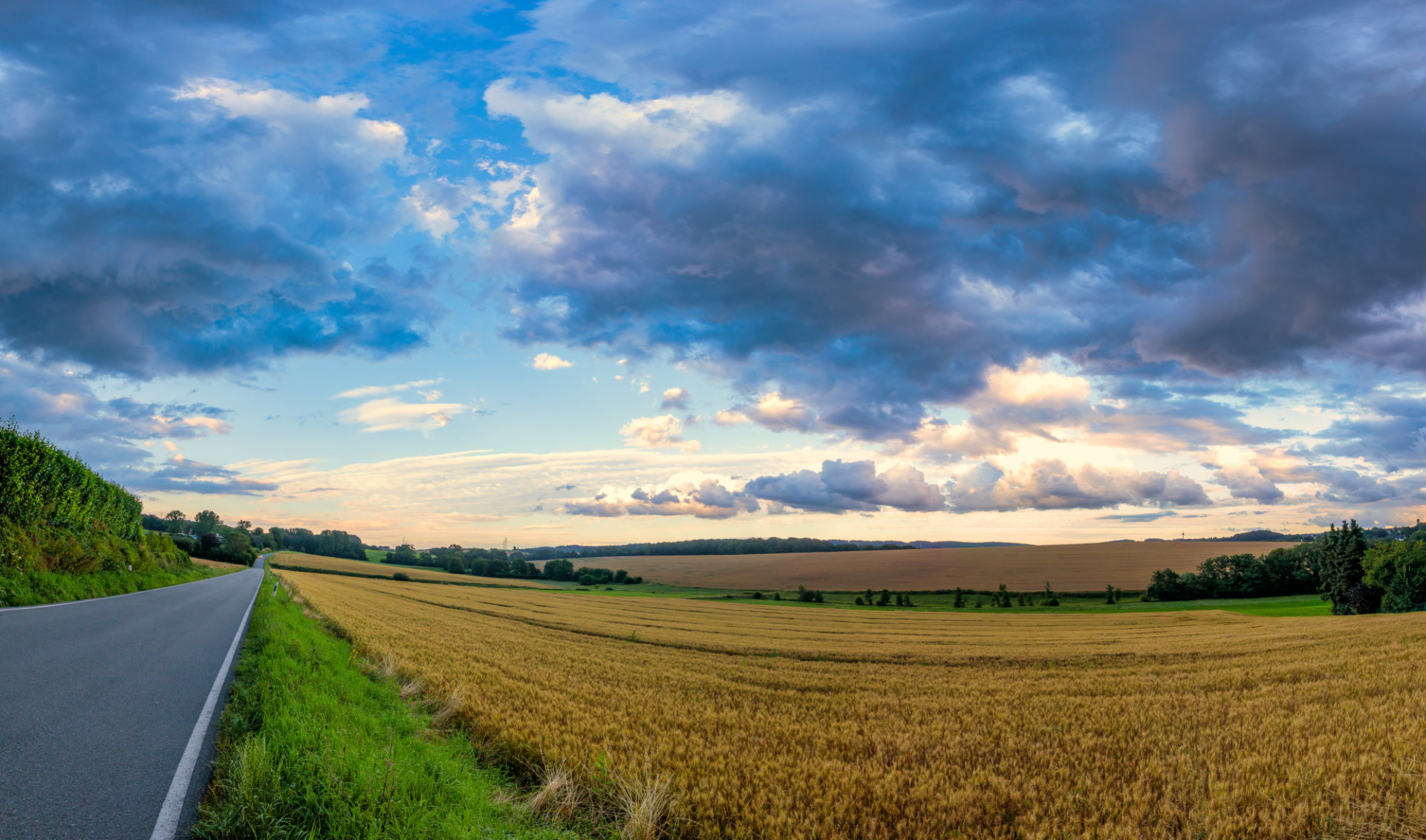 German country road with stormy clouds