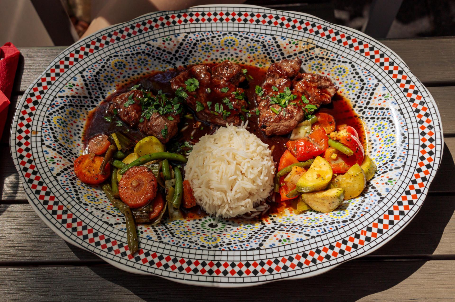 Arabian plate with lamb fillet served with rice and grilled vegetables