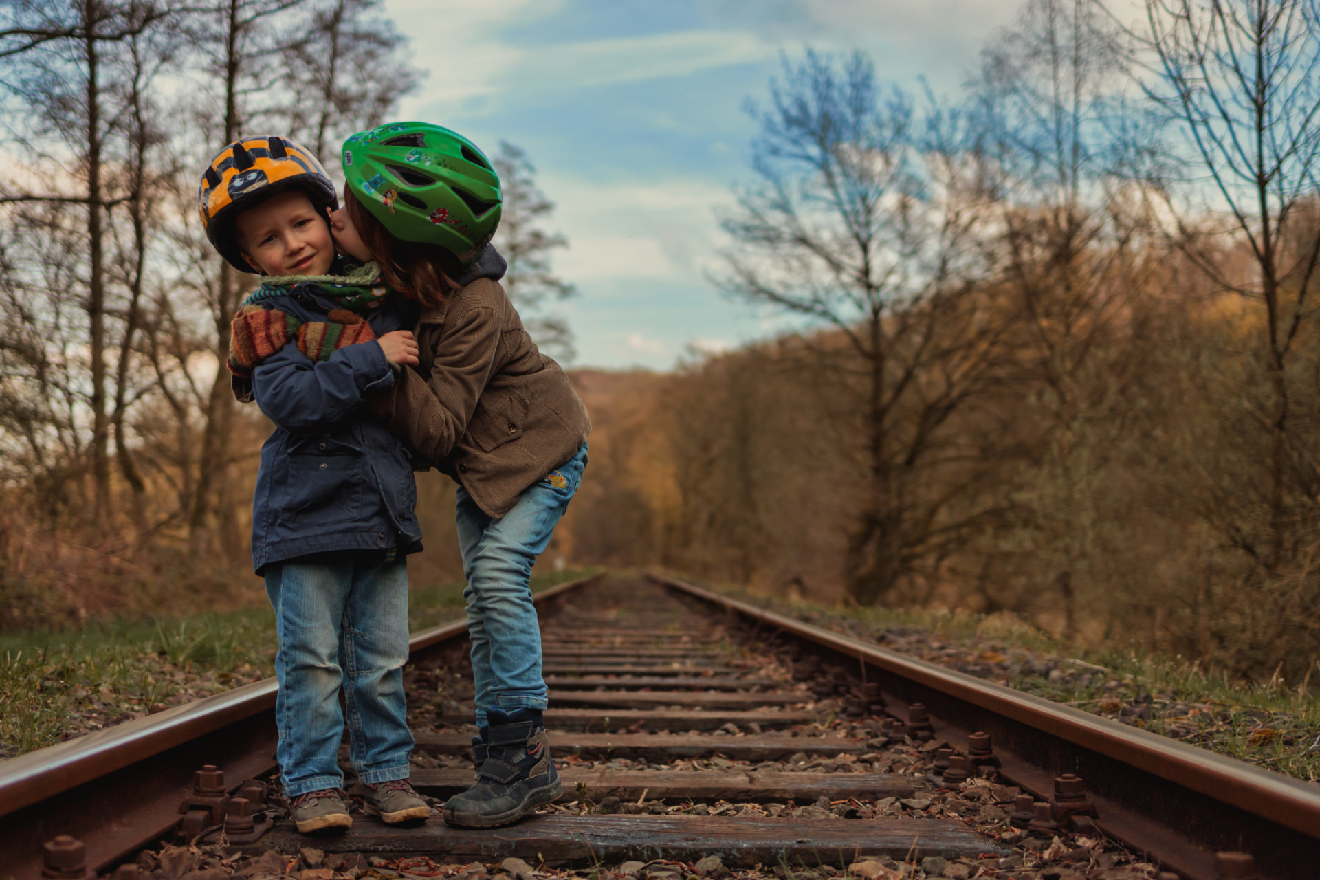 Two little brothers on an old disused railroad track