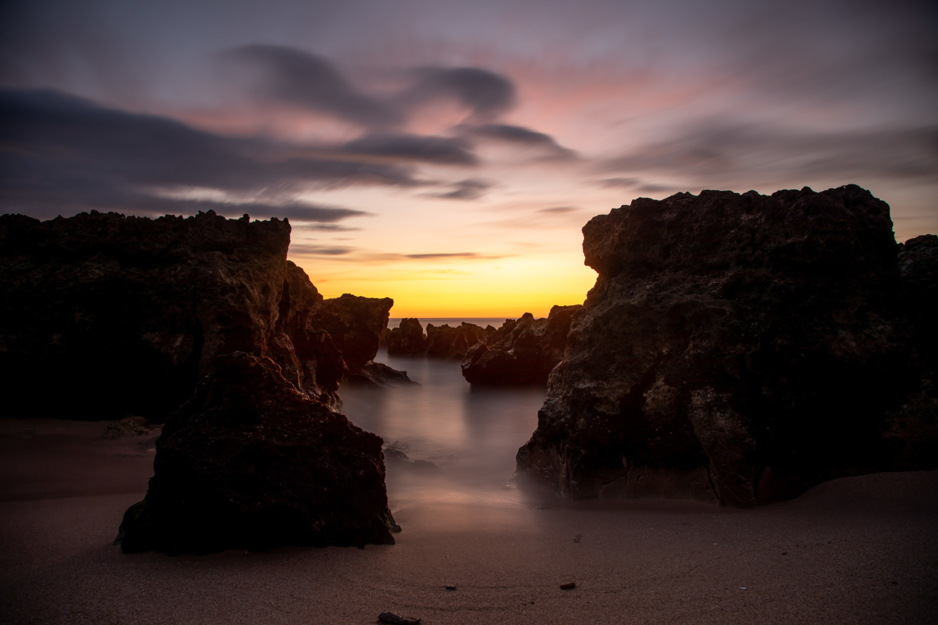 Wonderful sunset on the cliff-rich beach of Portugal Seascape