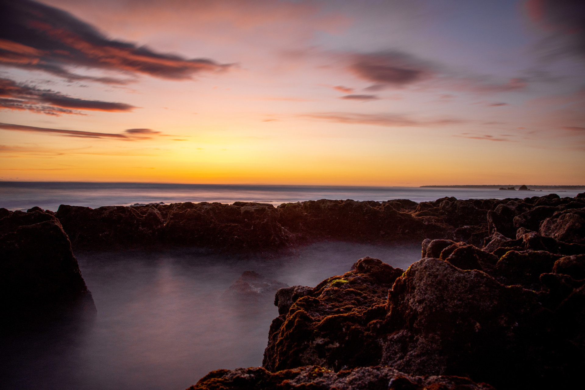 Wonderful sunset on the rocky beach of Portugal