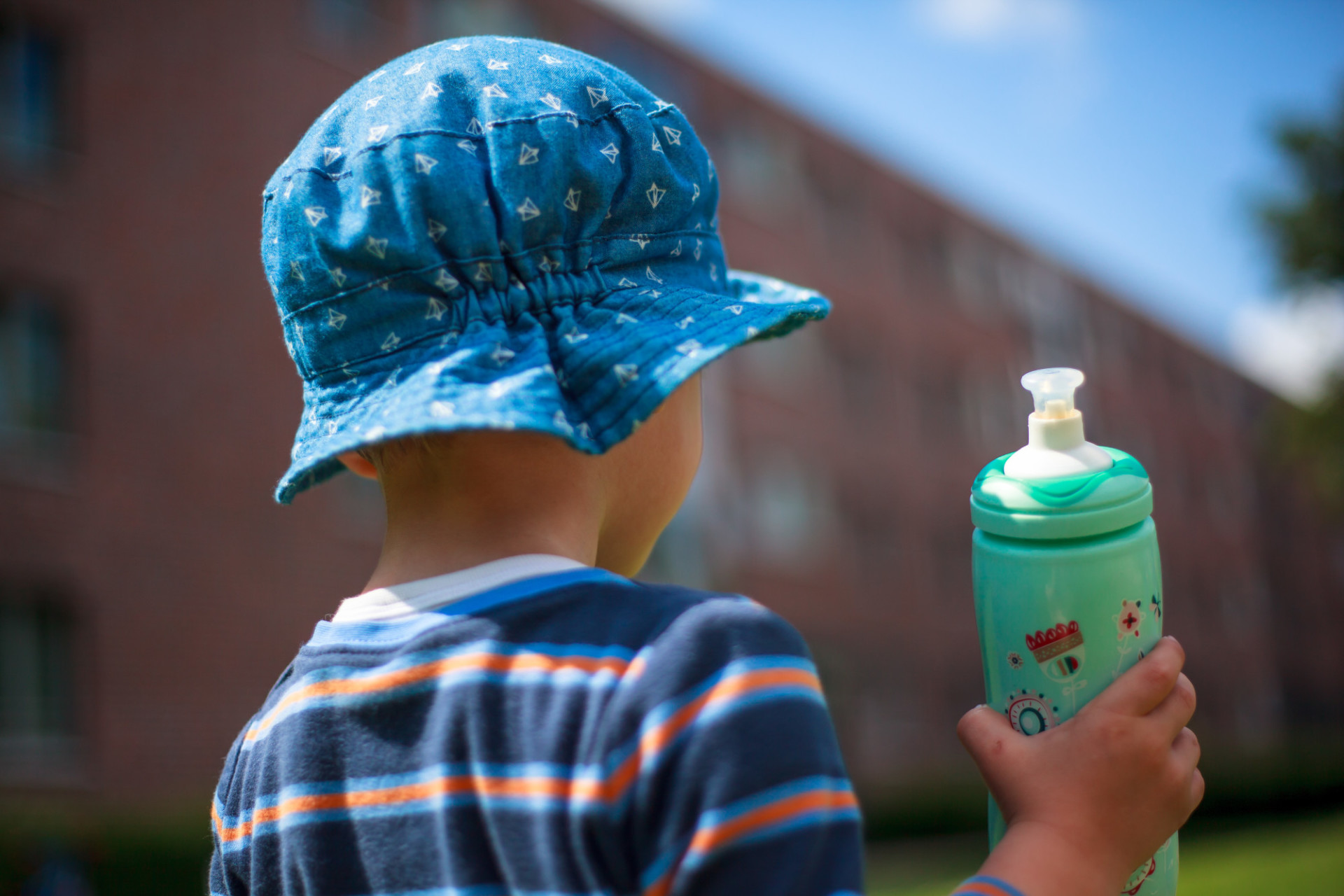 Toddler with plastic water bottle