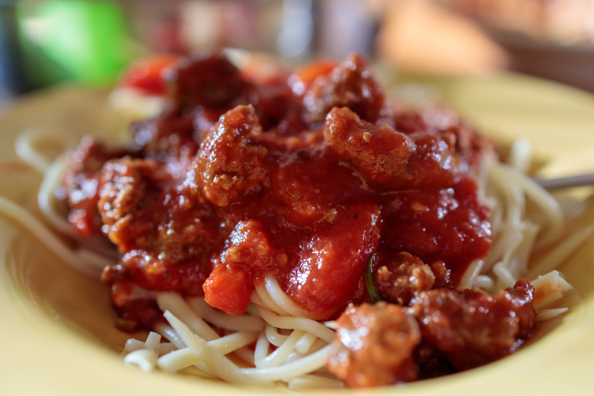 Spaghetti Bolognese on a yellow plate