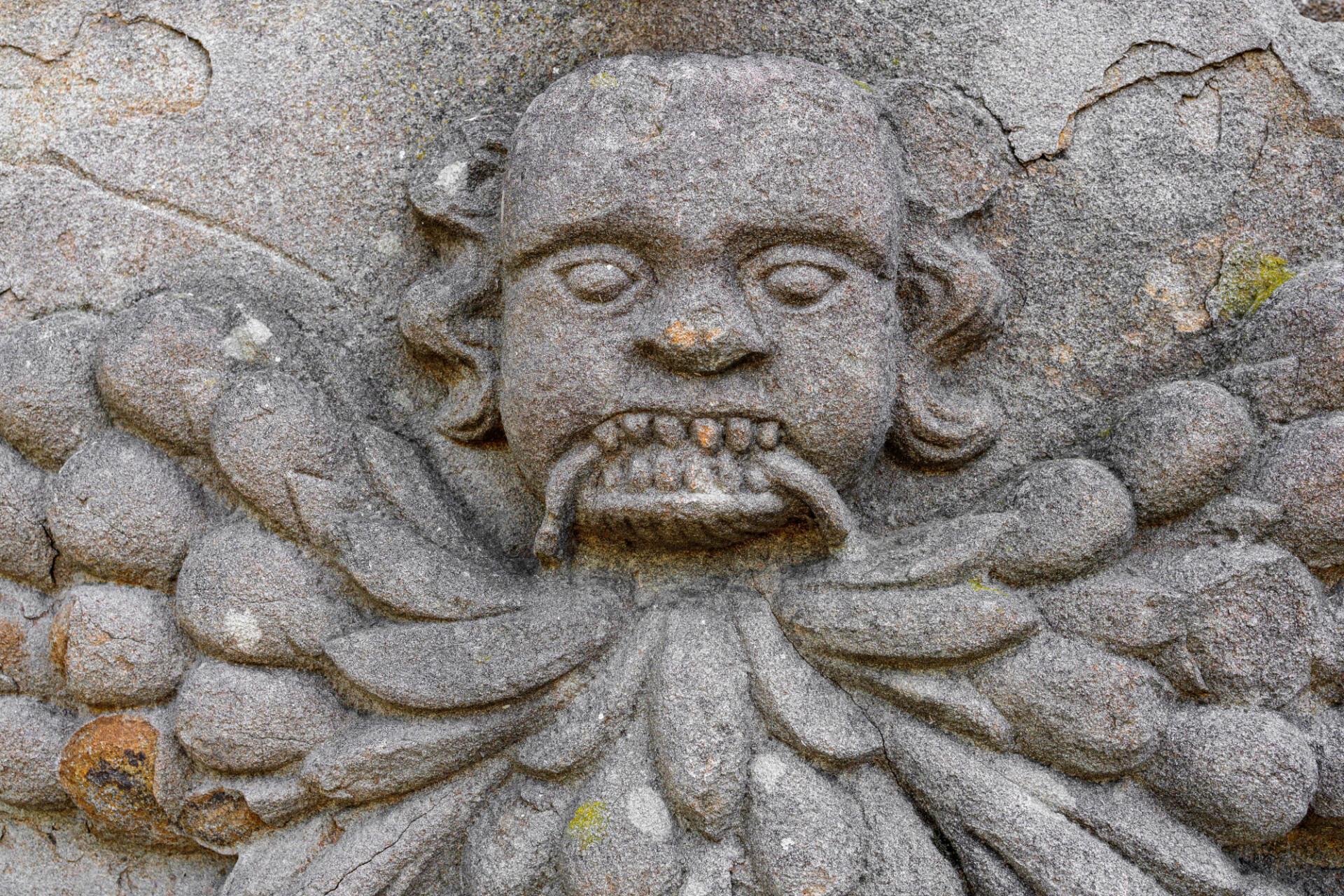 Medieval demon sculpture