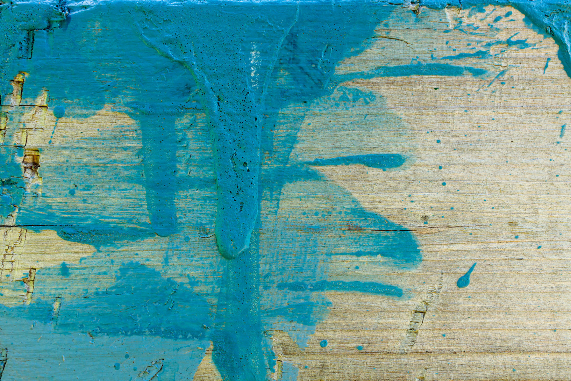 Wood with blue paint splotches
