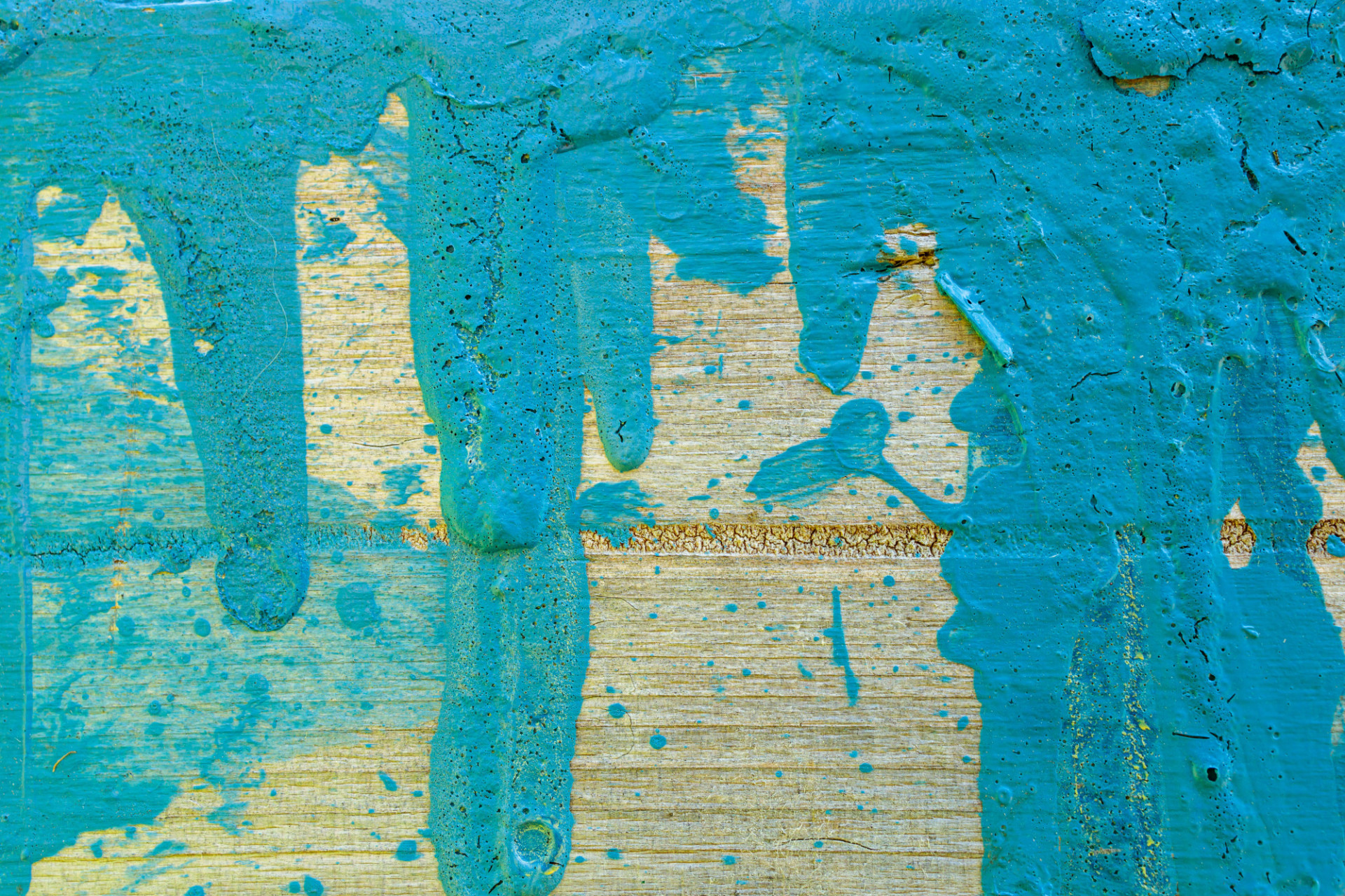 Wood with blue paint splotches background