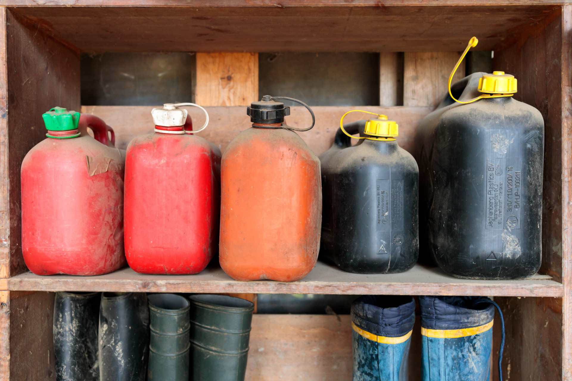 Old petrol cans on a shelf