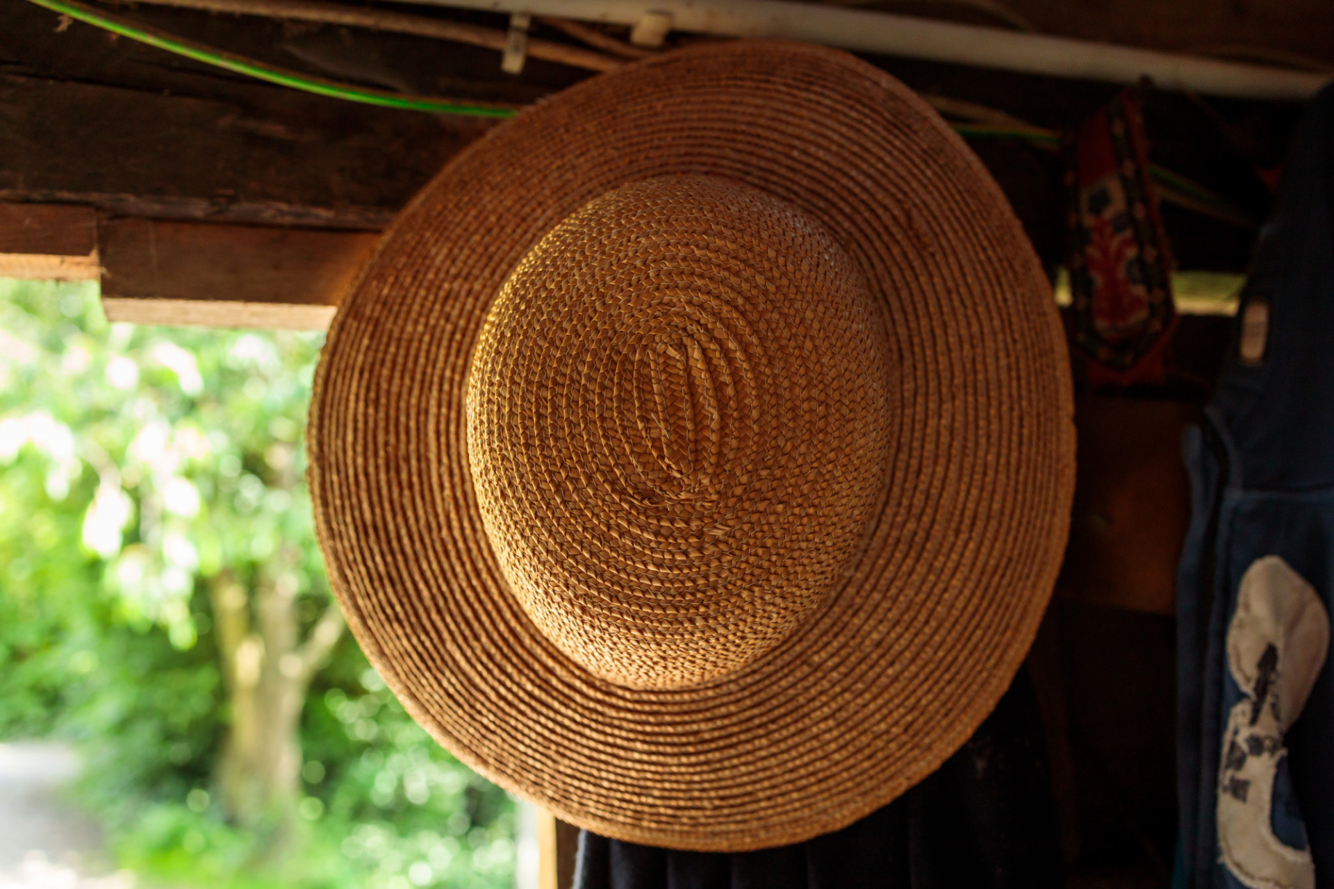 Straw hat hanging in a barn