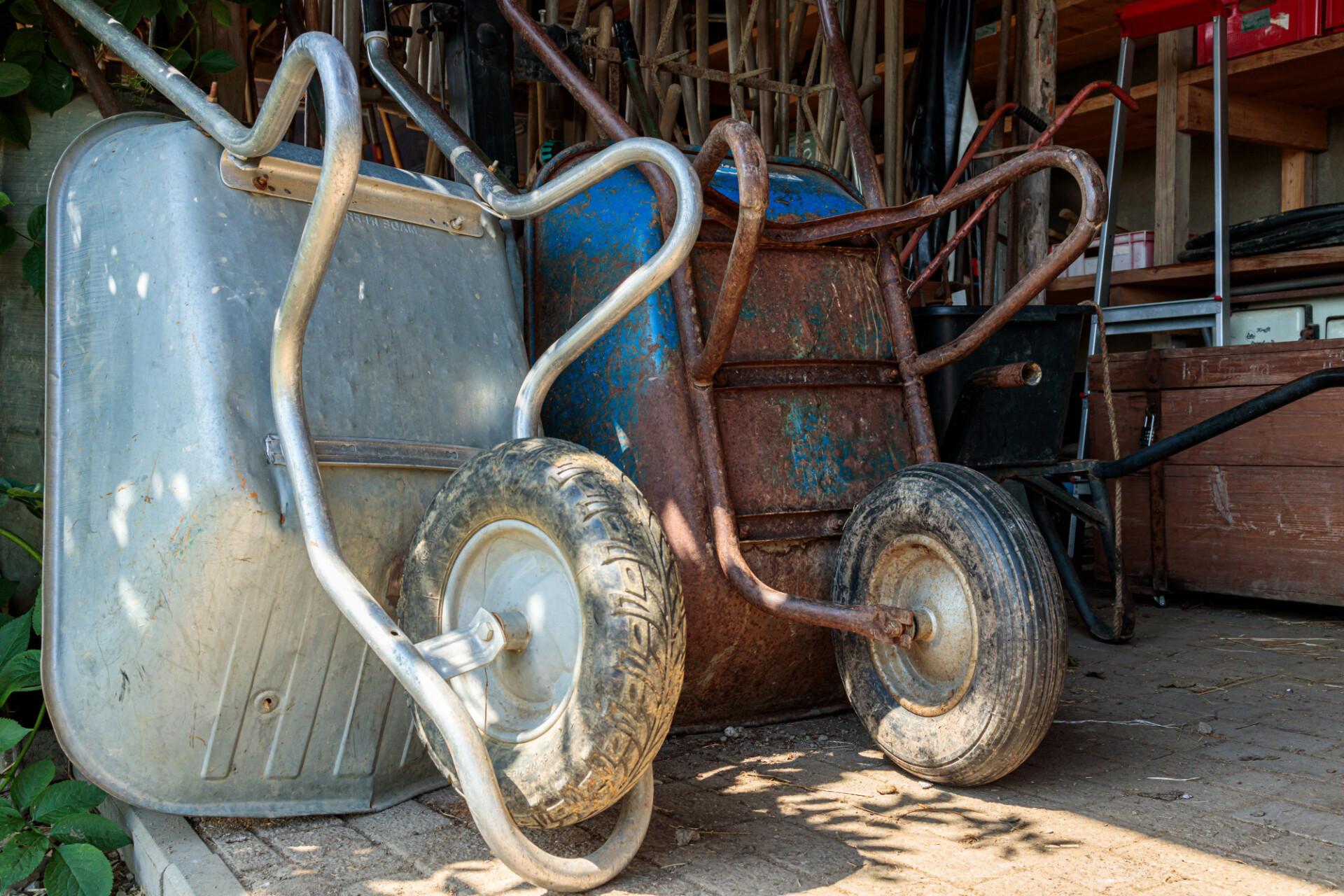 Old wheelbarrows in a barn