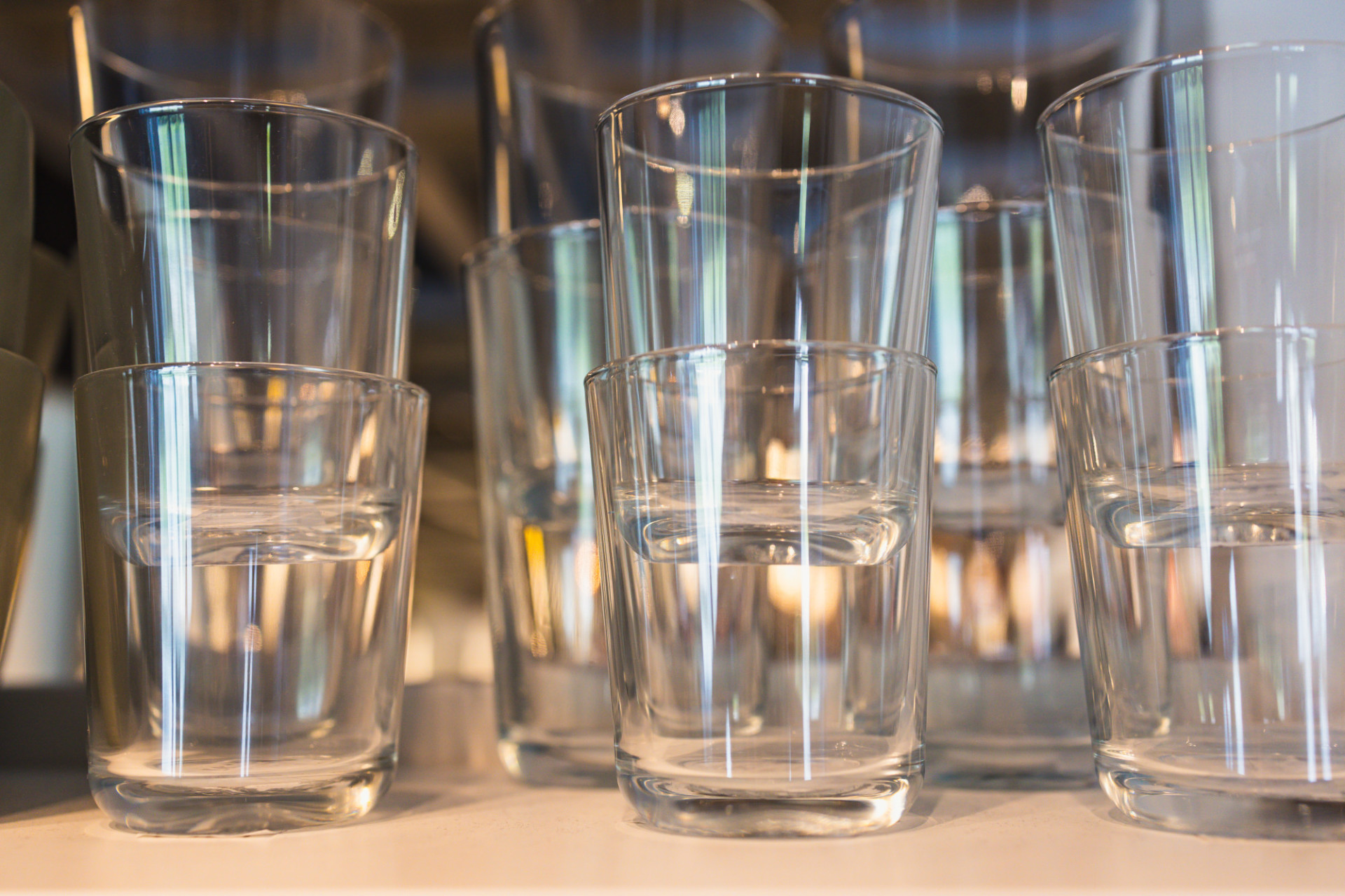 Drinking glasses in kitchen cabinet