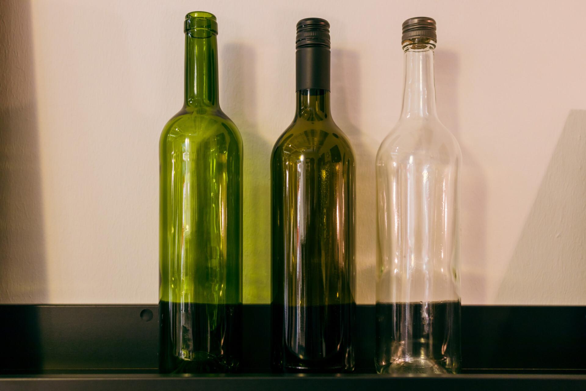 Empty wine bottles in three different shades
